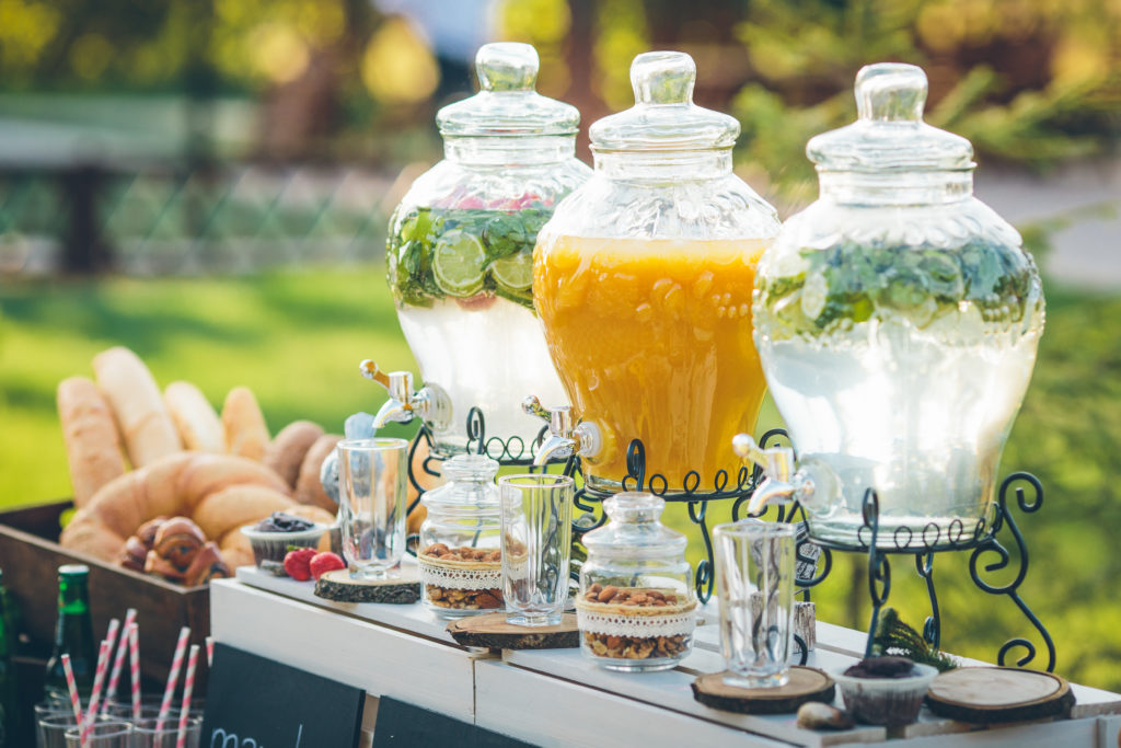 Glass jars of lemonade on wedding candy bar